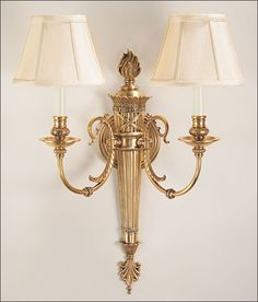solid brass wall sconce with reed and ribbon motif