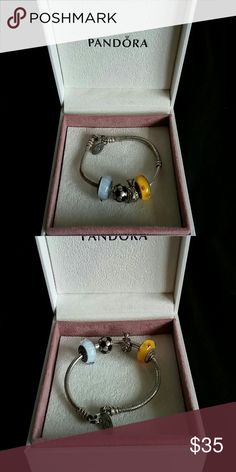 Authentic Girls Pandora braclet with 4 charms Authentic Girls Pandora braclet with 4 charms A soccer ball ,a giraffe and 2 multicored charms Never really worn so still in brand new condition Selling for $35.00 that's a steal!! Comes with original box Pandora Accessories Jewelry