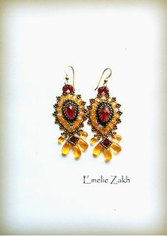 Check out Free shipping.Beaded earrings.Handmade Artisan Beadwork Earrings.   These are a great holiday accessory.BEADING on emeliebeads