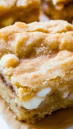 White Chocolate Snickerdoodle Blondies - A cross between a chewy blondie and moist butter cake, these blondies are studded with white chocolate chips and ribboned with sweet cinnamon sugar!..