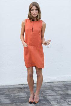emerson made  sleeveless mod dress  orange hankerchief weight linen, two welt pockets, hook and eye closure at slit neckline