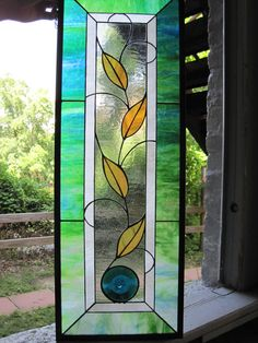 Stained Glass Leaves and Rondel Panel. $285.00, via Etsy.
