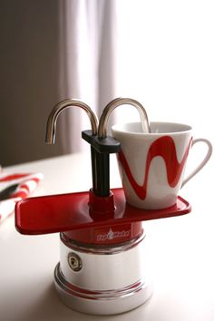 a super cool mini stovetop espresso pot! ( enter to win one here http://j.mp/JMm8SW )