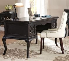 The Reflections Lescott Desk is a fantastic piece to organize your home office. The desk boasts a beautiful espresso finish with mirrored insets that reflect the light and add an elegant touch to this beautiful piece. The desk pairs perfectly with the matching Reflections File Console.