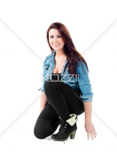 girl crouching down - Young woman kneeling down and smiling on white. Model: Sierra Walsh