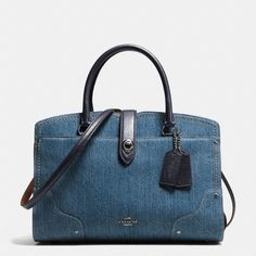 Denim adds a jolt of Western attitude to the effortlessly cool Mercer Satchel. Light in weight and full of function, its slightly structured silhouette is finished with corner details, industrial rivet hardware and an iconic turnlock closure.
