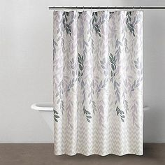 Foliage of varying shades of soft purple and gray on a snowy white background bring a muted, sophisticated style to your bathroom with the DKNY® Spring Willow Shower Curtain.