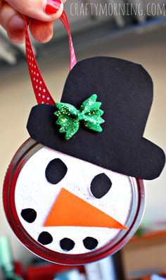 Snowman Mason Jar Lid Ornament for Kids to Make - Crafty Morning Materials Needed: Mason jar lid Card stock paper Glue/ Hot glue gun Ribbon Bow tie noodle Paint/Glitter