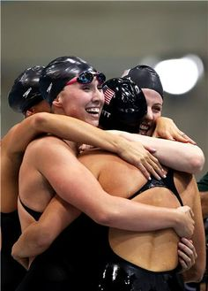 The U.S. women's 4x200m freestyle relay team celebrate gold glory.