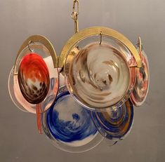 Excited to share this item from my #etsy shop: Midcentury Murano Disk Chandelier, Rare Italian Bright Colored Blue, Orange, Murano Pendant Light, Free Shipping, Wiring Comp USA #blue #orange #vintagechandelier #marbleeffectlamp #vintagedisklight #midcenturydisklamp