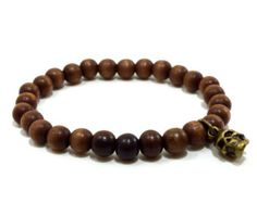 Mens brown wooden beaded stretch bracelet with antique gold skull charm
