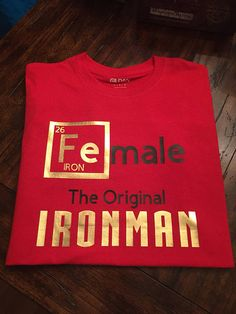 The shirt speaks for itself. It says Female The Original Ironman making a reference to the periodic table. The element and Ironman are made with foil gold vinyl, which is very shiny and makes the shirt stand out. Our shirts are made with professional vinyl and pressed with a machine for