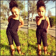 Clothing: Black romper jumper. Cheetah sandals.  Hair: big bun with gelled baby hair from old style by me