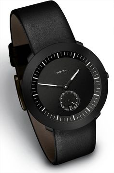 Until I find an extra $600 in the sofa cushions, I guess I'll just pin this Botta-Design watch. Love.