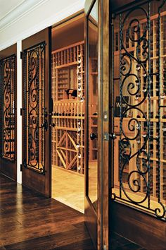 Luxury Wine Cellar Design I love the cast iron accents!