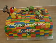 This was for my son's 6th birthday last year. He loves Lego and Angry Birds so it had to be a mashup of the two. Can't take credit for the birds as that was darling hubby but I made the pigs and slingshot etc...oh, and the cake of course! This year it's going to be the Monster Book of Monsters for his 7th birthday in October so fingers xd!