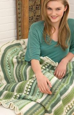 "Free Country Fields Lapghan Pattern -""Wonderful for relaxing, this design is reminiscent of rolling hills in shades of green. Crochet it using the colors shown, or any shades that will add the accent you need for your living room or bedroom."""