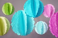 Cute decorations made from colored doilies. Fold in half and glue together til you have a sphere.