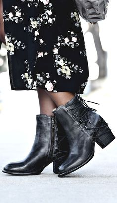 Black leather heeled short boot by BEDSTU. Back leather lacing gives this classic ankle bootie a feminine touch.