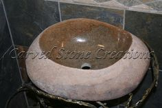 A unique one-of-a-kind sink carved from a single river rock and polished by hand from Carved Stone Creations.  No two are a-like!  We have several boulder sinks in our inventory. $697  Click on the image to see it in our online store. #vessel sinks #bathrooms