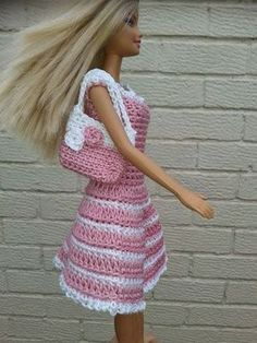 Lyn's Dolls Clothes: Barbie crochet dresses and bag ~ to fit Barbie (latest model) & most fashion dolls ~ FREE - CROCHETOver the last year I've had a lot of fun creating knitted and crochet clothes for my grandchildren's barbies and build a bears. Crochet Barbie Patterns, Crochet Doll Dress, Barbie Clothes Patterns, Crochet Barbie Clothes, Doll Clothes Barbie, Crochet Doll Pattern, Barbie Dress, Clothing Patterns, Crochet Dresses