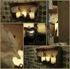 Kerst tafereeltje in een aan de muur gespijkerd mandereinen kistje! Nep kaarsen er in en klaar.