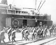 Soldiers board ship in Tampa, Florida to go to Cuba during the Spanish American War.