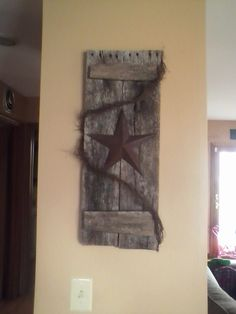 2 pieces of old barnwood, some vine and a rusty star.  A simple primitve addition to your home.