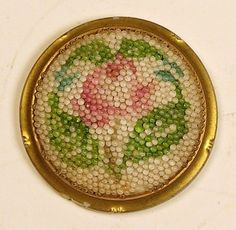 "MAGNIFICENT SCARCE ANTIQUE GLASS CORALENE (GLASS BEADING) ROSE BUTTON   THIS IS A MAGNIFICENT MEDIUM ANTIQUE GLASS BUTTON, WITH A CORALENE ROSE.  CORALENE IS  A RAISED DECORATION MADE UP OF TINY GLASS BEADING OR BALLS ON GLASSWARE, 1-1/16"" IN DIAMETER, 4-WAY BOX SHANK.   CONDITION IS EXCELLENT, ALTHOUGH THERE IS A CHIP ON THE REVERSE, WHICH DOES NOT EFFECT THE FRONT OF THE BUTTON!!!  SOLD $149.00"