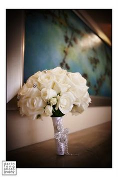 Beautiful flowers pinned by Balla Florists, County Mayo  - White rose bouquet with broach