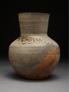 China is a highly skilled country in most aspects of art, but ceramics are what they're renowned for. This is a tall, ceramic neck jar.