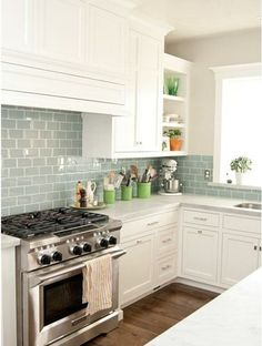 Kitchen I dream of. White cabinets, white marble counters and 'Surf' Green-blue glass subway tile backsplash.  I'm in love.
