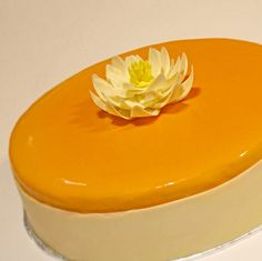 Coconut sponge cake layered with mango mousse and mango jelly. Decorated with mango glaze, white chocolate water lily and wrap.
