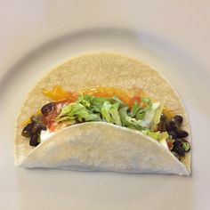 TACOS:  Corn Tortillas, Black Beans, Cheese, Avocado/Guacamole, Sour Cream, Salsa, Lettuce