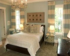I love this room with the striped curtains, light blue paint...
