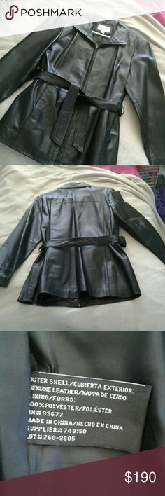 Leather Trenchcoat It's a black genuine leather trenchcoat, it looks like something a spy would wear in the movies. It zips up and it comes with a belt you can tie around the waist, so yeah it's a really nice coat. Worthington Jackets & Coats Trench Coats