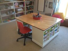 "Finished!  Kids' craft/board game/Lego table in the kids' playroom.  Sides made from Ikea Trofast storage units.  Top and bottom from 3/4"" plywood. Casters mounted to the bottom for easy movement."