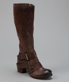 When the day starts off a little grim, indulge in the pleasures of lunch break retail therapy with this feel-better boot. Guaranteed to turn the day around, its Western-style silhouette is adorned with buckle details and a modest chunky heel. Slip into this stylish pair and all the flack will fall by the wayside. 3'' heel14'' shaft