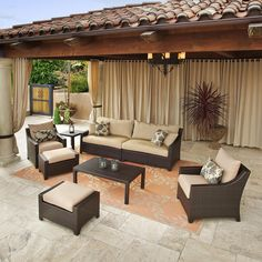This seven-piece outdoor sofa seating set from Delano is a beautiful addition to any backyard oasis. This outdoor set features two chairs, two ottomans, one sofa, one coffee table and a side table in a an espresso color.