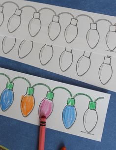 Christmas light coloring strips - a great way to practice patterning. Tape the strips together to make a very long strand of lights.