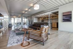 PV14 Dallas House Steel Ceilings Corrugated steel ceilings are left exposed—a reminder that this is, after all, a container converted into a home. Spray foam insulation keeps the space from experiencing extreme temperature shifts.