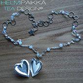 Valkoinen sydänmedaljonki 30€