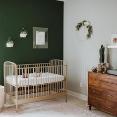 Our Larkin Gold Crib might have a simple design, but that doesn't mean it lacks style. This elegant metal crib features a unique arched design, giving it a softer look. Green Nursery Girl, Dark Nursery, Baby Nursery Decor, Nursery Room, Baby Room Green, Accent Wall Nursery, Vintage Nursery Boy, Project Nursery, Baby Boy Rooms
