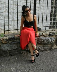 Black bustier top + colorful, flowy skirt