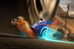 Turbo the snail speeds it up, racing cars in the Indy 500 in Dreamworks Turbo.