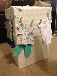 "Baby shower gift: decorated a large box with outfits hanging on a ""clothesline"". Easy and fun presentation."