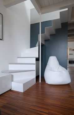 Italian architecture firm +R Piuerre has converted a dental practice at the top of a Milanese building into a 60-square-metre apartment.  the CPR Apartment comprises a lounge and kitchen-diner on one floor and a bedroom and office upstairs.