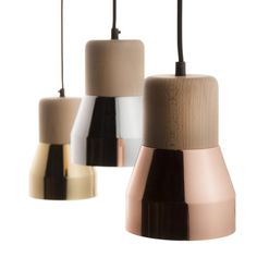 The cement wood lamp plays with materials. Another playful design from think Studio!. The Cement wood collection focuses on concrete and wood. It deals with a perfect balance between the roughness of concrete and the softless of wood, for cold and warm lights.