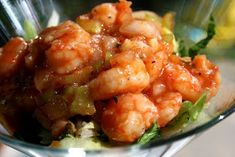 A spicy marinade of chili sauce, hot sauce, citrus vodka, horseradish, celery, garlic, sweet onion, and Cajun seasoning, tossed with shrimp for a fantastic appetizer.