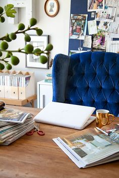 You can't see everything from this angle, but what you can, I love - the chair, the blue bulletin board, the filing system on a side table. (That's really one of the best chairs I've ever seen.)